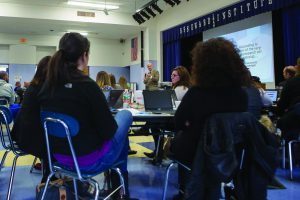 Teachers listen as Eric Sheninger presents to the crowd.