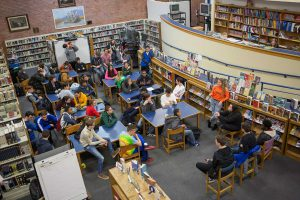 A busy high school library photographed from above