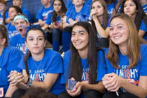 high school students cheer from the bleechers during a pep rally