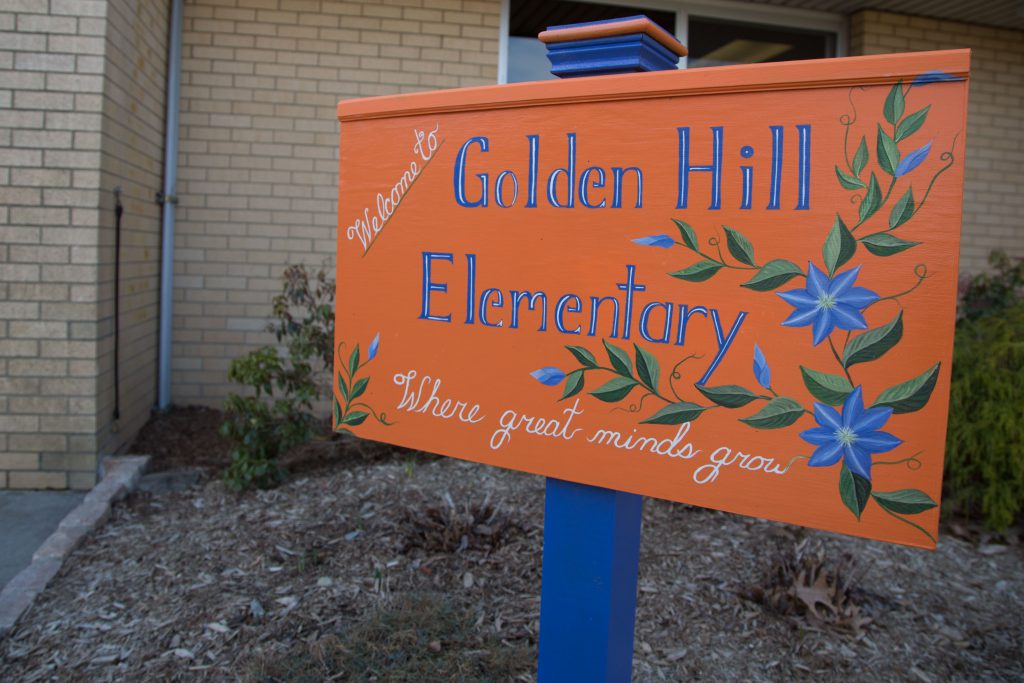 A welcome sign in front of Golden Hill Elementary