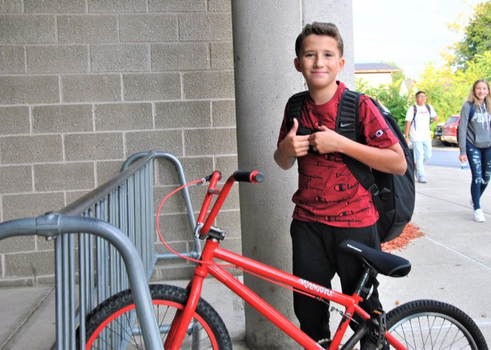 Student arriving at school by bicycle