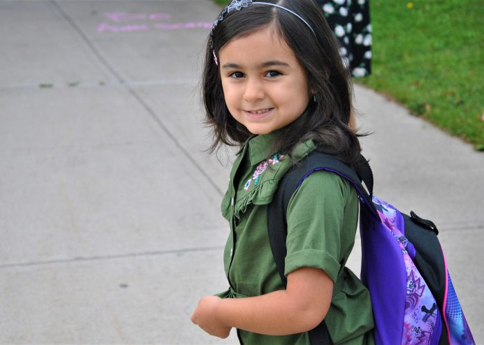 elementary student walking to school with backpack