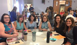 Faculty and staff sitting around a table during Opening Day