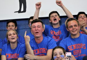 Students cheering from the gym's bleechers