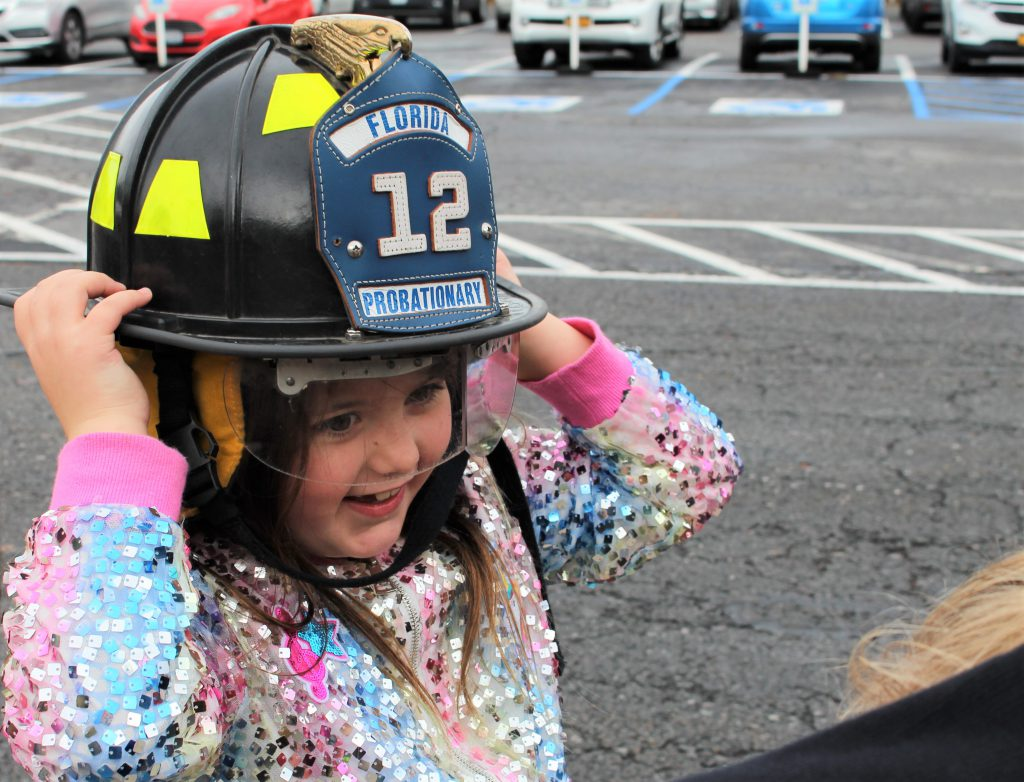 Student tries on firefighter hat